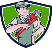 stock photo of overalls  - Illustration of a plumber in overalls and hat pointing monkey wrench looking to the side set inside shield crest on isolated background done in cartoon style - JPG