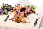 image of quail  - Roasted Quail with rosemary and spices on the wood background - JPG