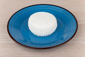 pic of curd  - Granular curd in blue glass bowl on table - JPG