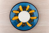 stock photo of curd  - Grainy curd with raisins and slices of peach in blue glass plate on table top view - JPG