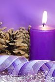 pic of lilas  - Christmas scene with burning candle and gift ribbon in lilac tone  - JPG