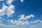 image of puffy  - white puffy clouds in the blue sky - JPG