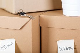 image of packing  - Pile of brown cardboard boxes with house or office goods - JPG