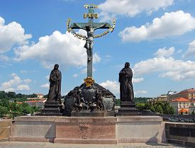 stock photo of calvary  - Statue of the Holy Crucifix and Calvary along the North side of Charles Bridge  - JPG