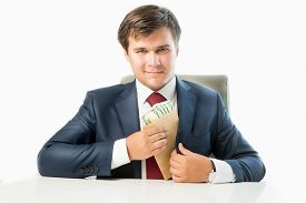 pic of politician  - Isolated portrait of venal politician putting money in envelope in pocket of his suit - JPG