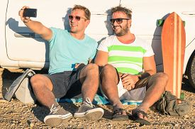 foto of  friends forever  - Young hipster best friends taking a selfie sitting next to the car  - JPG