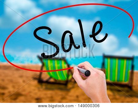 Man Hand Writing Sale With Black Marker On Visual Screen