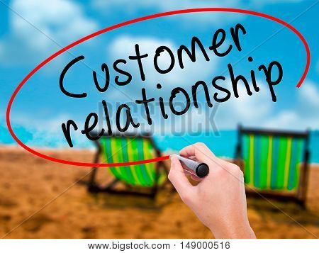 Man Hand Writing Customer Relationship With Black Marker On Visual Screen
