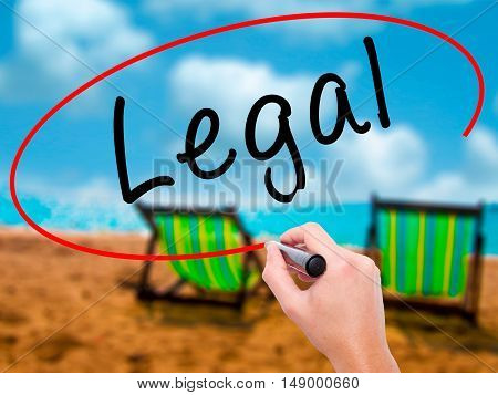 Man Hand Writing Legal With Black Marker On Visual Screen