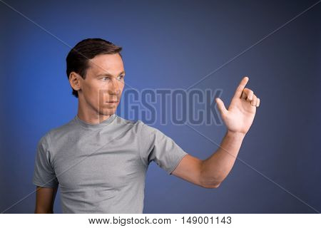 Man working with virtual touch screen.