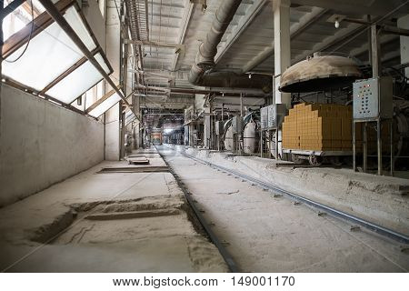 Industry. Image of old dusty workshop at brickyard