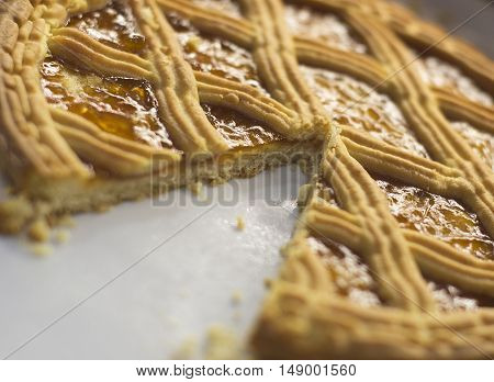 dish with apricot tart in a white plate