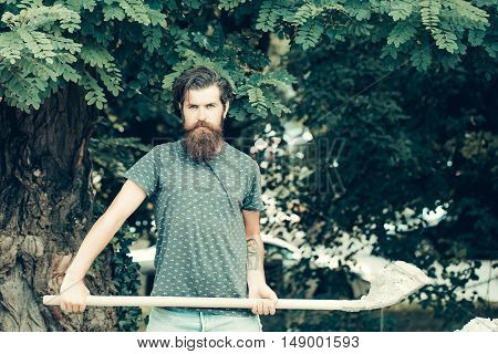 Young Bearded Man Holding Shovel