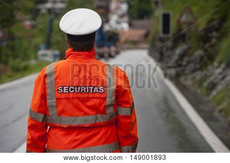 Police in hi-visibility jackets securitas traffic control on the road.