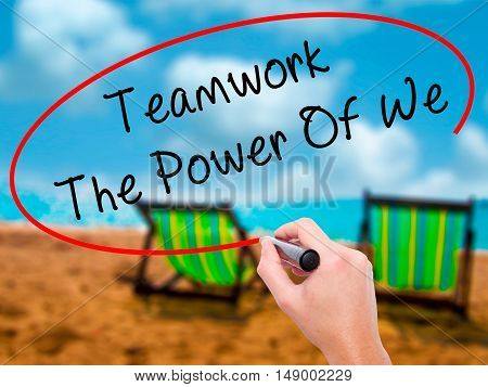 Man Hand Writing Teamwork - The Power Of We With Black Marker On Visual Screen