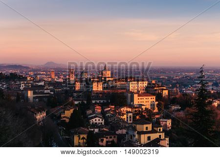 Medieval old town in Bergamo during beautiful sunset seen from the hill