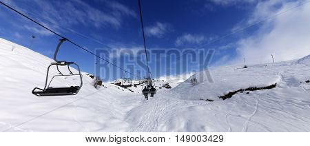 Panoramic View On Chair-lift At Ski Resort At Sun Winter Day