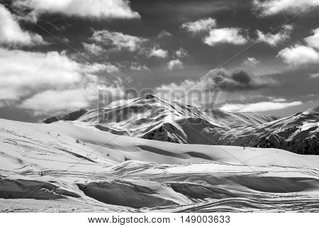 Black And White Ski Slope And Beautiful Sky With Clouds In Sun Evening