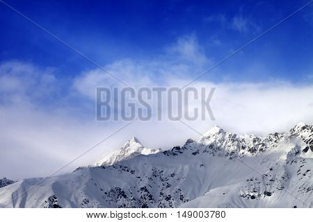 Snow Sunlight Mountain Peak In Fog And Blue Sky