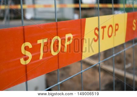 stop sign ribbon on a construction site