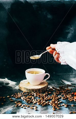 Close-up Of Coffee Cup With Roasted Coffee Beans On Black Backgr