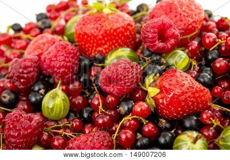 background of different fruits: raspberries gooseberries currants strawberries