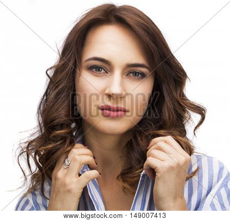 Happy brunette woman in a striped blue shirt, isolated on white background