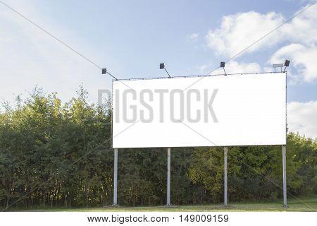 Mock up. Outdoor advertising, horizontal blank billboard outdoors, public information board on city road