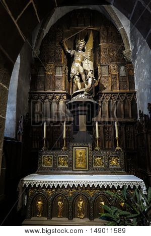 Mont Saint Michel France - September 8 2016: The interior of the church of St. Peter in the Mont Saint-Michel in Normandy France. Side altar of the holy Michael