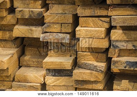 The pack is not very neatly stacked pine boards