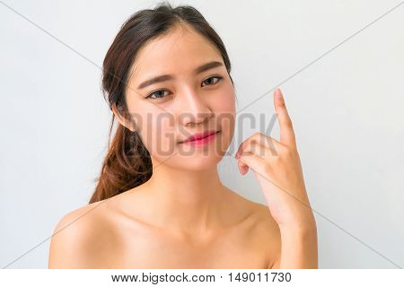The Portrait Of A Beautiful Female Model On White Background