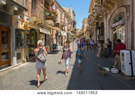 Corso Umberto - street in Taormina, Sicily, ITALy, many people in summer evening on Corso - street in Taormina, Sicily on July 2, 2015 Sicily