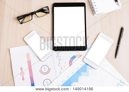 Tablet And Two White Smartphones