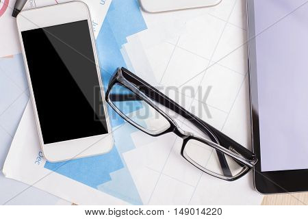 Cellphone And Tablet On Business Report