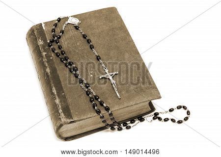 Ancient book and rosary Catholic (prayer beads)