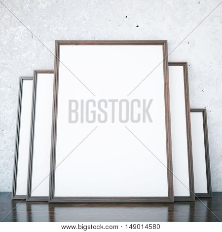 Room with several empty picture frames leaning on concrete wall. Mock up 3D Rendering