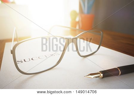 Closeup of eyeglasses and pen on document with message. Success concept. 3D Rendering