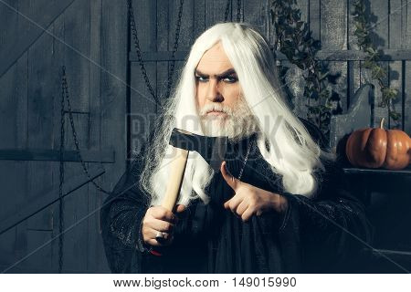 Grey-haired Man In Costume Of Wizard