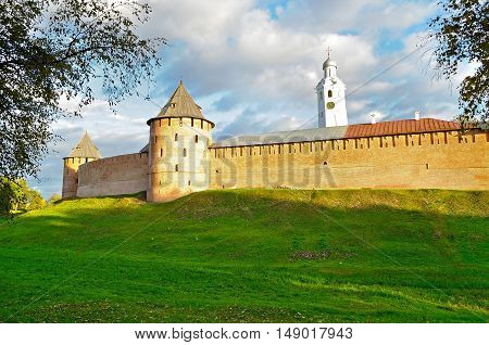 Architecture autumn colorful landscape - Veliky Novgorod Kremlin and clock tower on the hill under warm autumn sunset light in Veliky Novgorod Russia