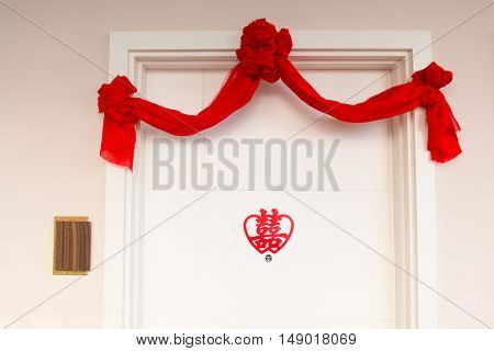 Auspicious traditional Chinese Wedding decor on main door to mean double happiness.