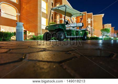 Golf Car At Resort On Night. Down View