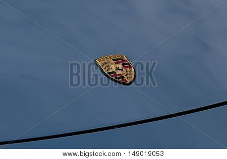Moscow, Russia - September 10, 2016: Porsche sign on the blue car hood