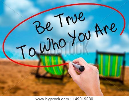 Man Hand Writing Be True To Who You Are With Black Marker On Visual Screen