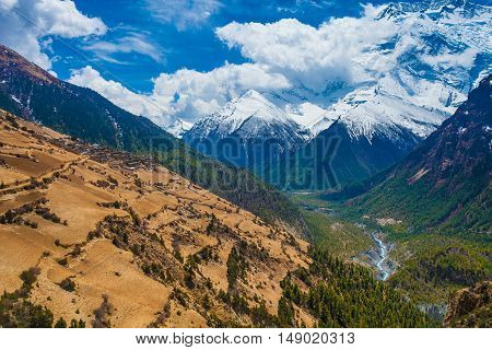 Beautiful Landscape View Snow Mountains Nature Viewpoint.Mountain Trekking Landscapes Background. Nobody photo.Asia Travel Sport.Horizontal picture. Sunlights White Clouds Blue Sky. Himalayas Way