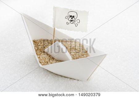 Brown sugar in a boat in a white sugar sea