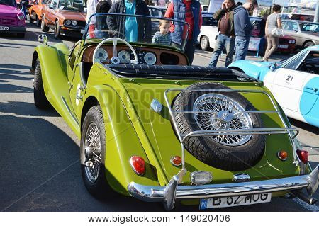 CLUJ-NAPOCA ROMANIA - SEPTEMBER 24 2016: Morgan Plus 4 roadster classic car made by the Morgan Motor Company from 1950 to 1969 in parking lot.
