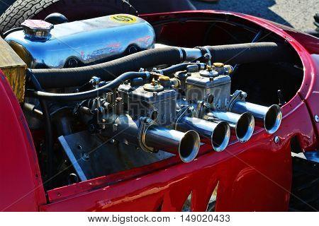 CLUJ-NAPOCA ROMANIA - SEPTEMBER 24 2016: Engine of Stanguellini Formula Junior oldtimer racing car parked in Polus Center parking lot