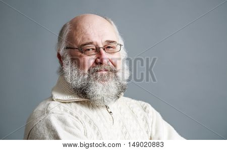 Portrait of Old Man with Beard on Gray Background. Senior Mature Man. Copy Space.