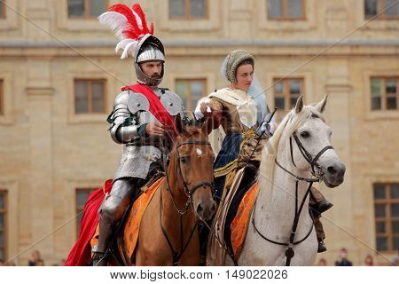 GATCHINA, ST. PETERSBURG, RUSSIA - SEPTEMBER 10, 2016: Actors in images of Emperor Nicholas I with his wife in front of Gatchina palace during the festival Gatchinskaya Byl. It is held first time