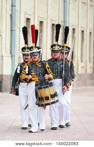 GATCHINA, ST. PETERSBURG, RUSSIA - SEPTEMBER 10, 2016: Guards with military drummer in front of Gatchina palace during the festival Gatchinskaya Byl. The festival is held first time this year